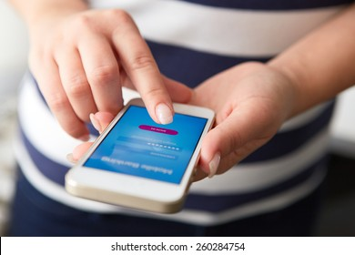 Female hands using mobile banking on white smartphone