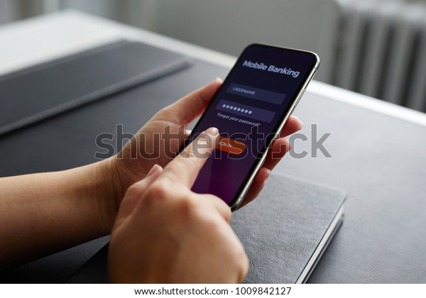 Female hands using mobile banking on smartphone