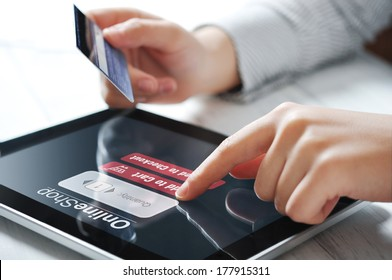 Female hands using touch screen device for online payment