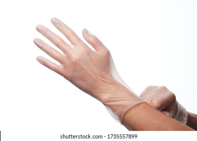 Female hands using vinyl gloves