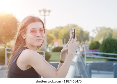 Female hands using white blank smartphone on the street, Look in camera