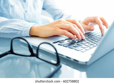 Female hands or woman office worker typing on the keyboard