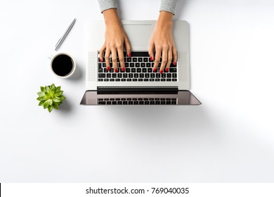 Female hands working on modern laptop.