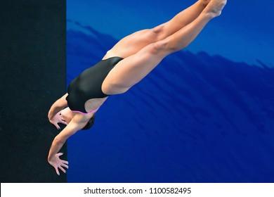 Female handstanding dive