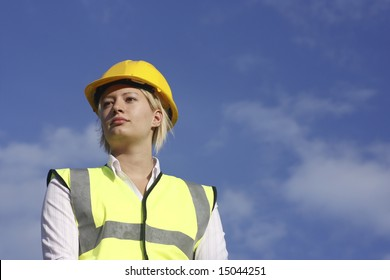 Female in a hard hat and safety vest.