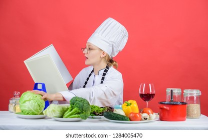 Female in hat and apron knows everything about culinary arts. Improve cooking skill. Culinary expert. Woman chef cooking healthy food. Girl read book best culinary recipes. Culinary education concept.