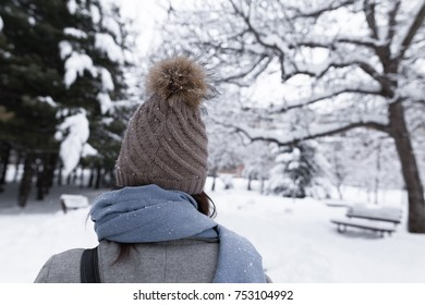 Female with hat in winter nature, shot behind