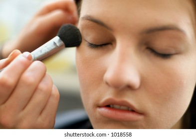 Female having make up applied in Beauty Salon