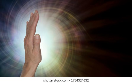 Female healer with powerful palm chakra energy -  upright open hand facing out with a spiral vortex energy radiating against a warm brown  background with copy space on right