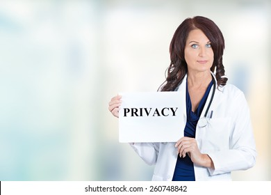 Female healthcare professional doctor scientist researcher pharmacist holding privacy sign isolated hospital windows background. Confidentiality patient care medical record information HIPAA concept