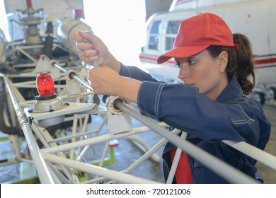 female helicopter maintenance worker