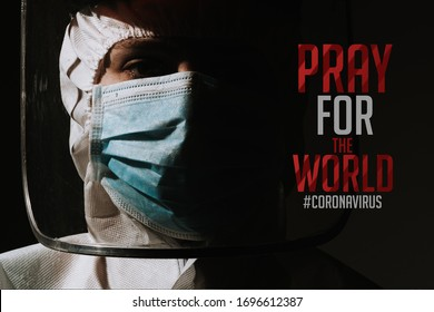 Female hero doctor with mask and face shield crying tear due to coronavirus covid-19 with text pray for the world