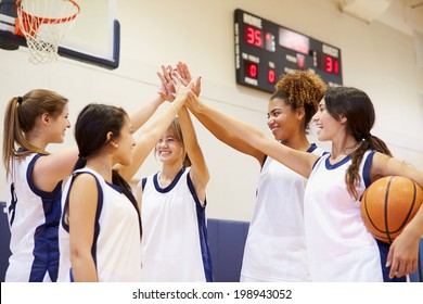 Female High School Basketball Team Having Team Talk