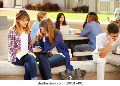 Female High School Student Comforting Unhappy Friend