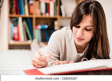 Female high school student making notes