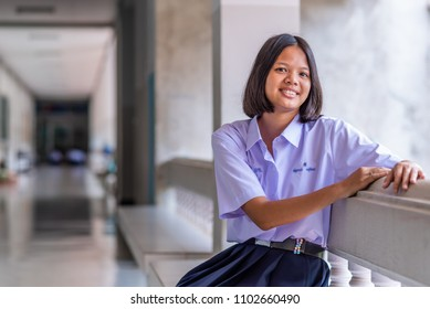 Female high school student in uniform, southeast Asia.