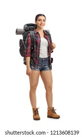 Female hiker with backpack standing and looking at the camera isolated on white background