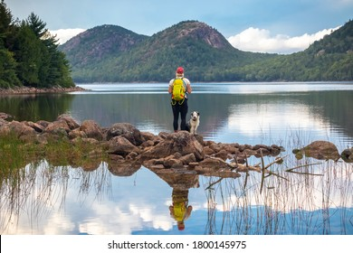 Female hiker and dog at Jordan Pond and The Bubbles, Acadia National Park, Maine