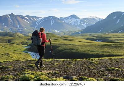 Female hiker enjoying the landscape of Iceland while hiking the Laugavegur trail.