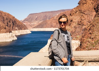 Female Hiker at Famous Hoover Damn Hydroelectric Power Plant at the Nevada-Arizona border.