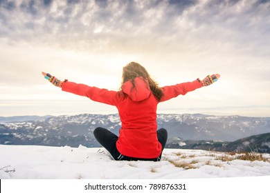 Female hiker on snow covered mountain top. Winter active lifestyle
