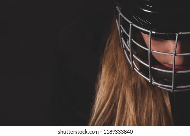 Female hockey player close up helmet and mask