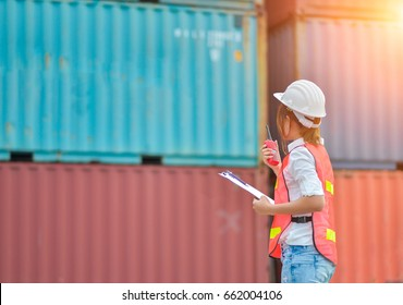 Female hold worker control loading Containers box to truck and discuss problem  by walkie talkie  for  Logistic Import Export Background, Business logistic concept