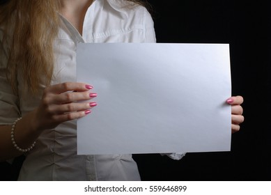 Female holding a blank sheet of paper