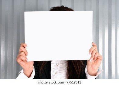 A female holding a blank sign