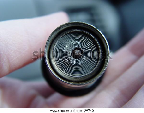 Female holding a car coil lighter, taken closeup