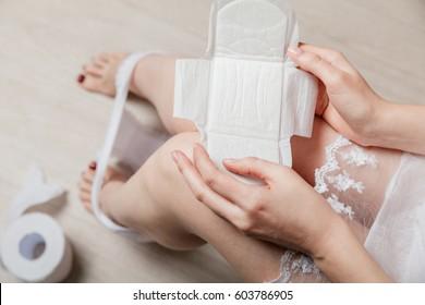 Female holding female's hygiene means