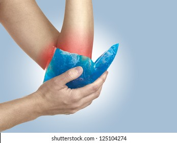 Female holding ice gel pack on elbow. Medical concept photo. Isolation on a white background. Color Enhanced skin with read spot indicating location of the pain.