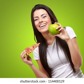 Female Holding A Piece Of Pizza And A Apple On Green Background