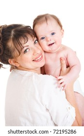 Female holding smiling baby in hands
