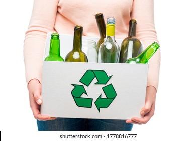 Female holding waste glass in recycling bin