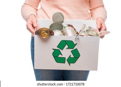 Female holding waste metal in recycling bin
