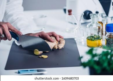 Female homeopath preparing herbal remedies