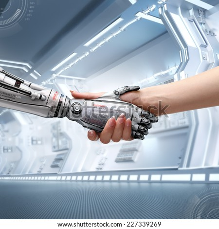 female human and robot's handshake as a symbol of connection between people and artificial intelligence technology