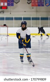 Female ice hockey athlete during a pre-game warm-up