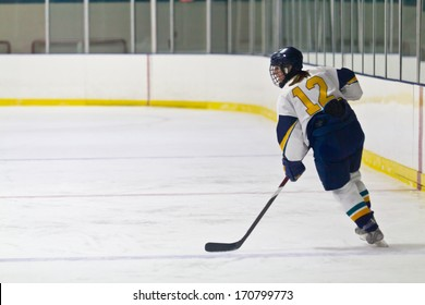 Female Ice hockey player during a game in an arena