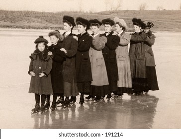 Female ice skaters lined up for a photo