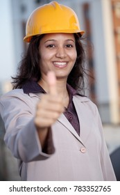 Female industrial engineer with thumbs up gesture