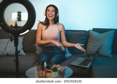 Female influencer vlogging online  with smartphone cam and laptop from home - Youth people with social media and smart working concept