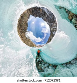 Female inside the crack in the ice glaciers Iceland. spherical 360 180 panorama of little planet.