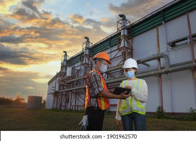 female inspectors and architects discuss with head engineer about construction project.Multi-ethnic group of engineers meeting at construction site in eveing time