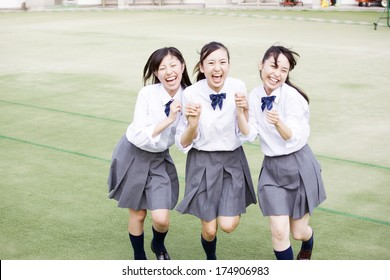 female Japanese students laughing together