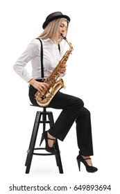 Female jazz musician seated on a chair playing a saxophone isolated on white background