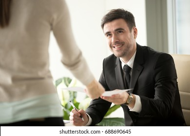 Female job applicant arrives at interview, gives resume to friendly hr recruiter, smiling customer manager receives application from client, happy boss takes document for signing, first impression
