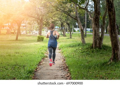 Female jogger.a healthy outdoor lifestyle.young fitness woman running on the road in the morning.