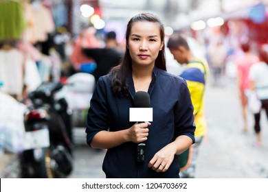 Female Journalist Outside Broadcasting on urban in Bangkok, Thailand.